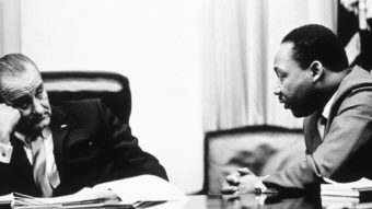 President Lyndon Johnson and civil rights leader Martin Luther King Jr. discuss the Voting Rights Act in 1965. On Wednesday, the Supreme Court hears arguments on whether a key part of the law is still needed nearly a half century after its passage. Hulton Archive/Getty Images