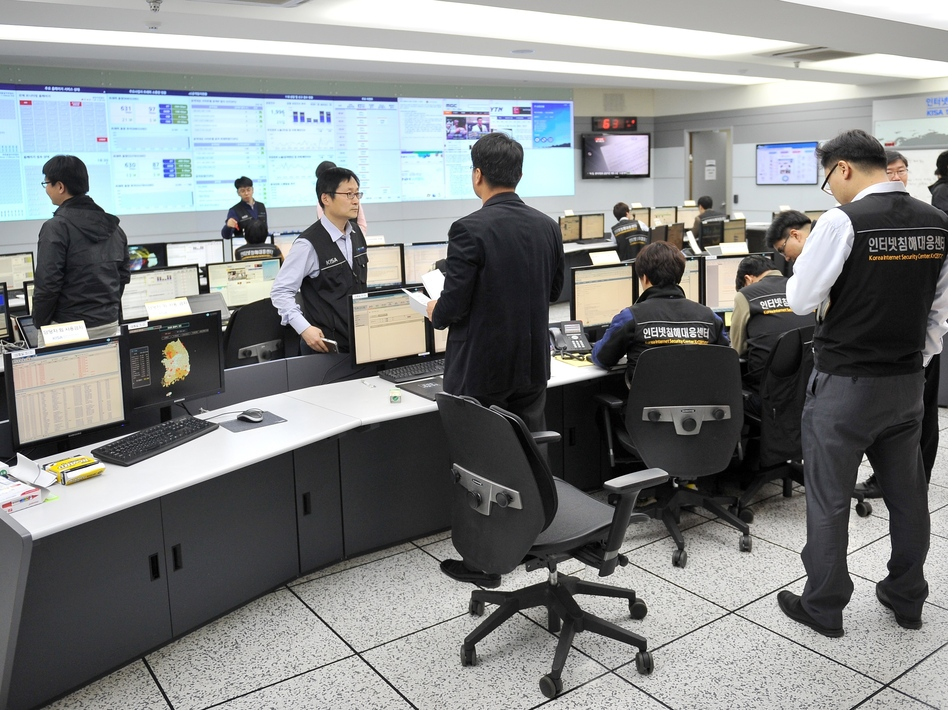 Members of the Korea Internet Security Agency check on cyberattacks at a briefing room Wednesday. Jung Yeon-Je/AFP/Getty Images