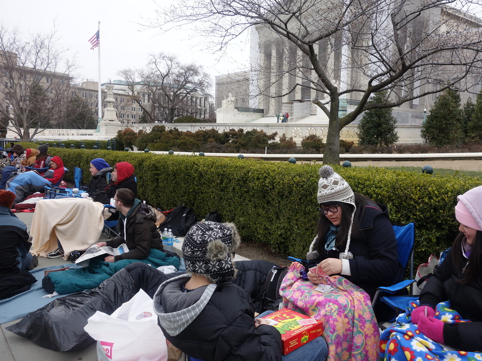 More than two dozen people bundled up to camp out before the U.S. Supreme Court for a seat to watch oral arguments in a same-sex marriage case on Tuesday. Elise Hu/NPR