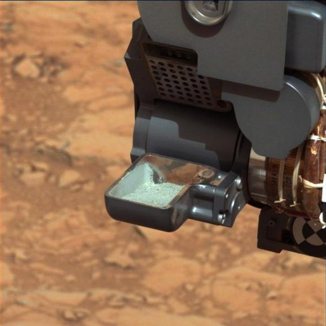 This image from NASA's Curiosity rover shows the first sample of powdered rock extracted by the rover's drill. NASA/JPL-Caltech/MSSS