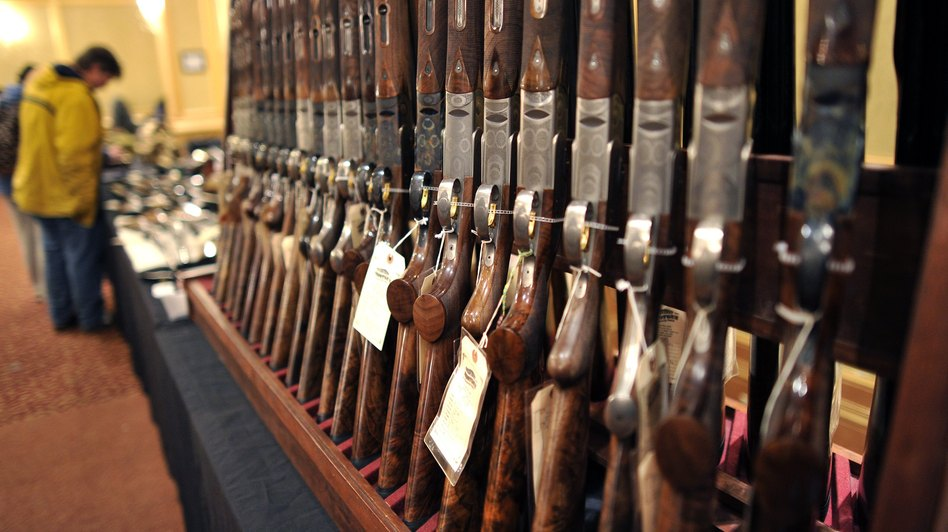 Shotguns sit on display at a gun show in Stamford, Conn. in January. Timothy A. Clary/AFP/Getty Images