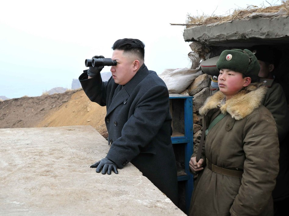 In this image released by North Korea's Central News Agency, leader Kim Jong Un is said to be using a pair of binoculars to look south during an inspection of a front-line army unit. Xinhua /Landov