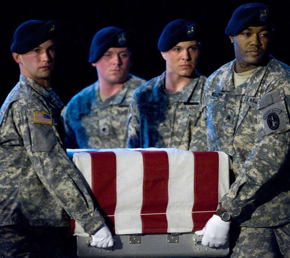 Members of the US Army's Old Guard carry team lift the remains of U.S. Army Specialist Israel Candelaria Mejias from San Lorenzo, Puerto Rico, as his body is returned on a C-17 to the U.S. from Iraq on April 7, 2009. Paul J. Richards /AFP/Getty Images