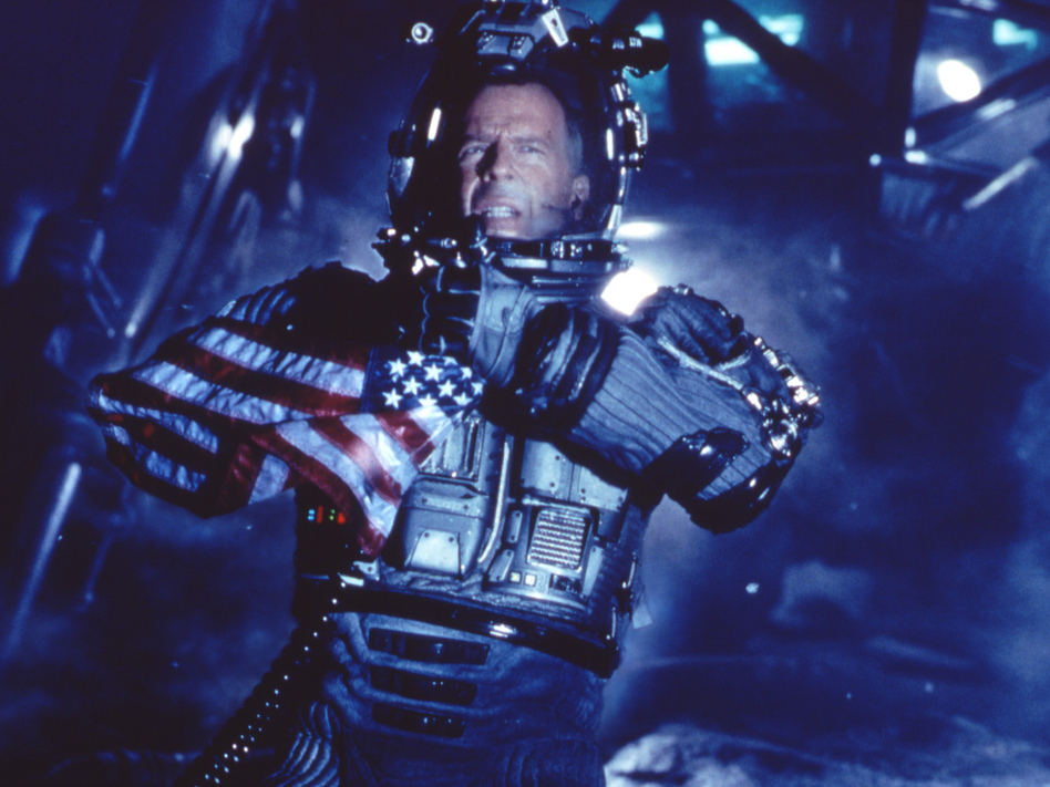 Actor Bruce Willis on the surface of an asteroid from the movie Armageddon. Lawmakers are questioning the likelihood of the movie's plot becoming reality. Frank Masi/Associated Press
