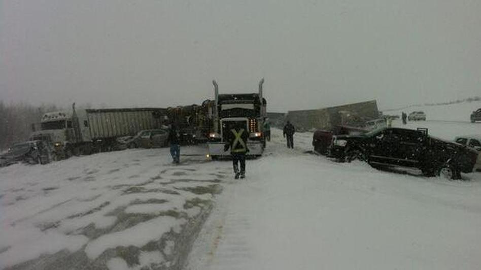 A blizzard traps cars, trucks and even a cattle car on a Canadian highway, causing dozens of mild injuries. Derek Fildebrandt/Twitter