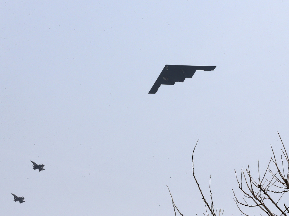 U.S. Air Force B-2 stealth bomber flies over near Osan U.S. Air Base in Pyeongtaek, south of Seoul on Thursday. Shin Young-keun/Associated Press
