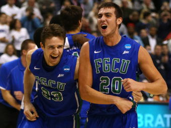 Florida Gulf Coast players Eddie Murray (No. 23) and Chase Fieler (No. 20) celebrate their win Sunday over San Diego State. The game was played at the Wells Fargo Center in Philadelphia. Elsa/Getty Images