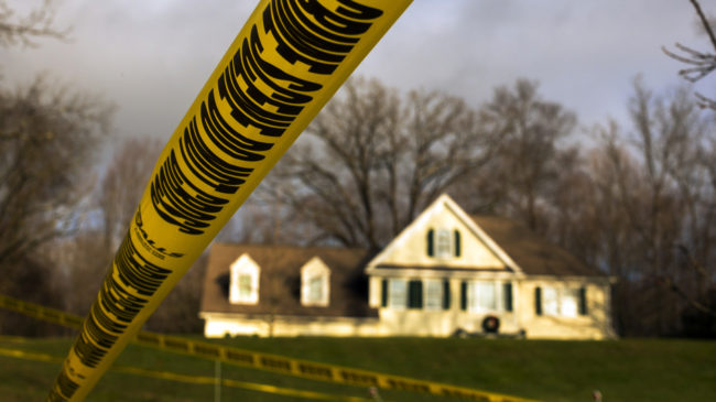 Dec. 18, 2012: Crime scene tape stretches across the property outside the home of Adam Lanza and his mother, Nancy Lanza. Inside, police found more weapons and other evidence. Lucas Jackson /Reuters /Landov