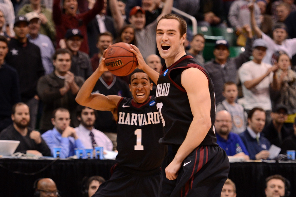Siyani Chambers and Laurent Rivard of the Harvard Crimson celebrate as the Crimson defeat the New Mexico Lobos 68-62 during the the 2013 NCAA Men's Basketball Tournament on Thursday in Salt Lake City, Utah. Harry How/Getty Images