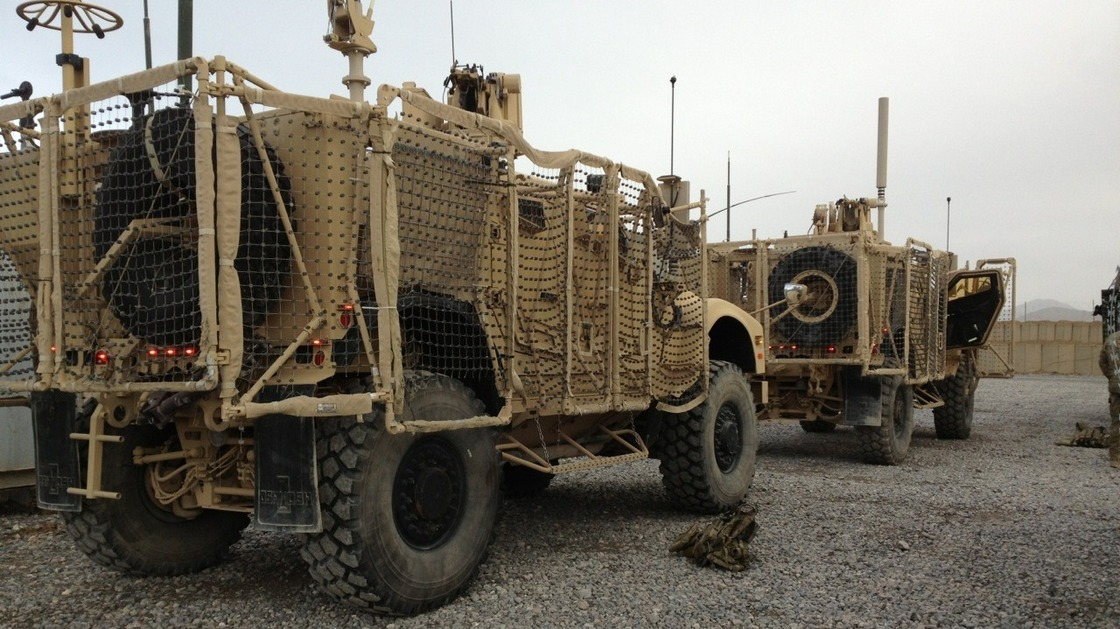 A pair of mine-resistant, ambush-protected vehicles are lined up for a convoy to Kandahar Airfield. One of the trucks broke down before leaving Forward Operating Base Frontenac. The unit has to move out 50 vehicles from the compound. Sean Carberry/NPR