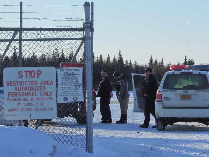 Leroy B. Dick, Jr., 42, in custody at the Dillingham airport. Dick is facing first degree murder charges for the killing of Manokotak VPSO Thomas Madole. Credit Jason Sear, KDLG