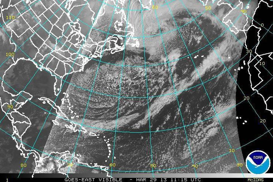 That's the coast of the U.S. on the left, the tip of Greenland at the top center and the coast of Europe on the top right. Meanwhile, the storm's tail extends down into the Caribbean. NOAA Satellite and Information Service