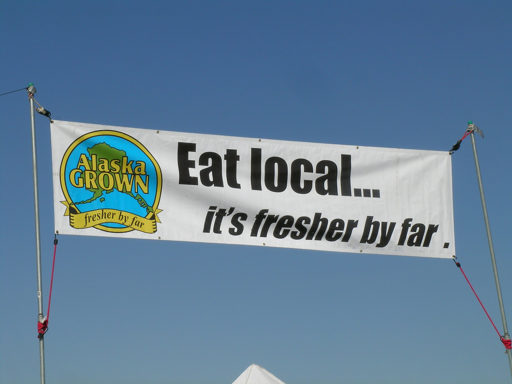 Alaska Grown banner at a farmer's market
