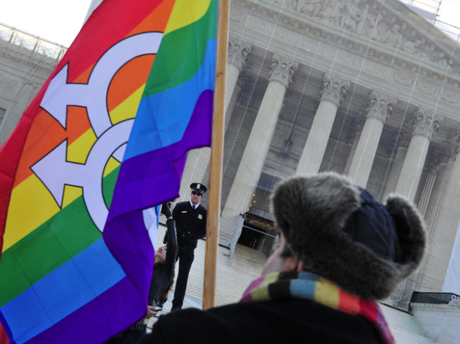A pro-gay-marriage protester stands in front of the Supreme Court on Tuesday, the first of two days of oral arguments on challenges to laws that limit the definition of marriage to unions of a man and a woman. Karen Bleier/AFP/Getty Images