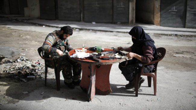 Members of Jabhat al-Nusra clean their weapons, in Aleppo in December. The Islamist rebel group has become an increasingly powerful force in Syria's civil war. Ahmed Jadallah/Reuters /Landov