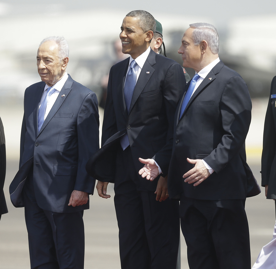 President Barack Obama is greeted by Israeli President Shimon Peres, left, and Israeli Prime Minister Benjamin Netanyahu upon his arrival ceremony at Ben Gurion International Airport in Tel Aviv, Israel, on Wednesday. Pablo Martinez Monsivais/AP