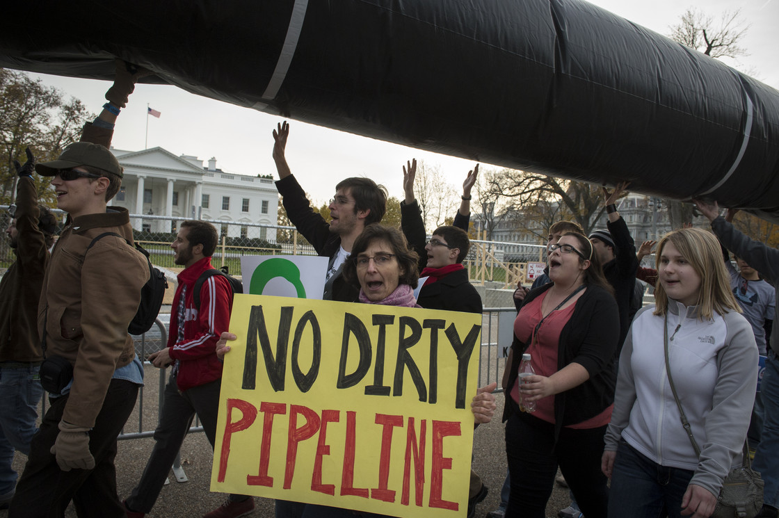 Demonstrators carry a mock pipeline as they pass the White House to protest the Keystone Pipeline, in Washington, D.C., on Nov. 18, 2012. Rod Lamkey Jr. /The Washington Times /Landov