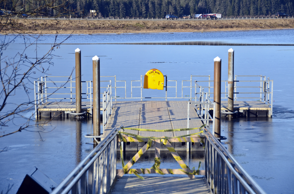 The ramp sits on the sidewalk, blocking access to the floating dock.