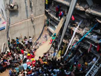 Volunteers on Thursday use a length of textile as a slide to move victims from the rubble of a collapsed building in Savar, Bangladesh. AFP/Getty Images
