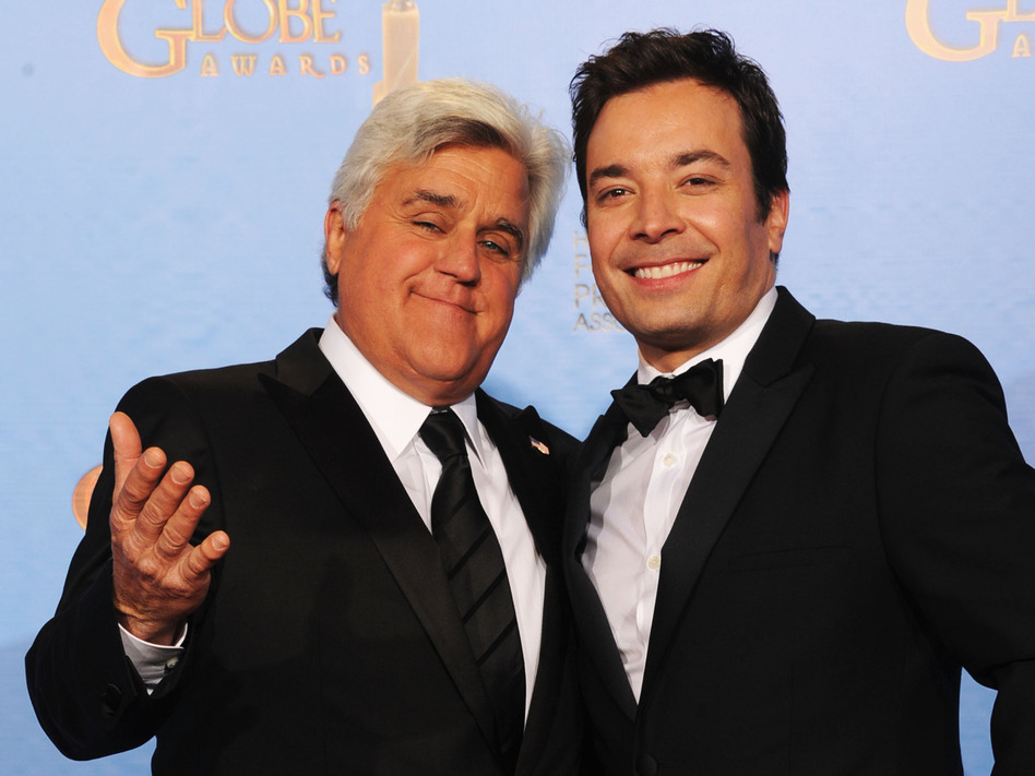 Jay Leno (left) and Jimmy Fallon at the Golden Globe Awards in January. Next year, Fallon will be taking Leno's place on The Tonight Show, NBC says. Kevin Winter/Getty Images
