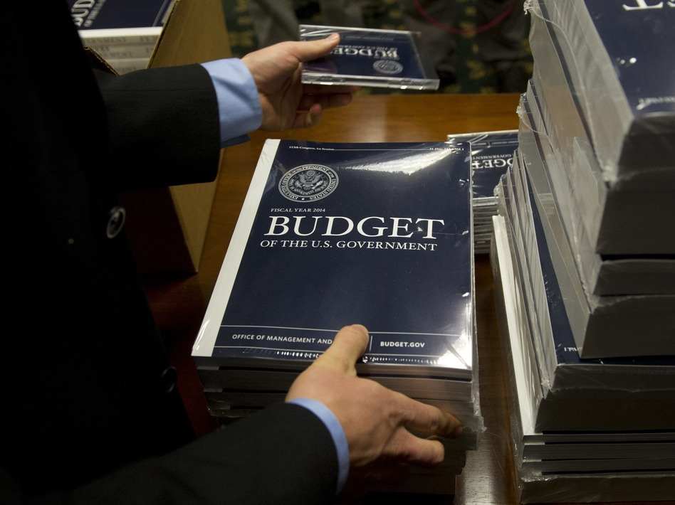 Senate budget committee staffers unpack boxes of President Obama's 2014 budget proposal on Wednesday. Saul Loeb/AFP/Getty Images