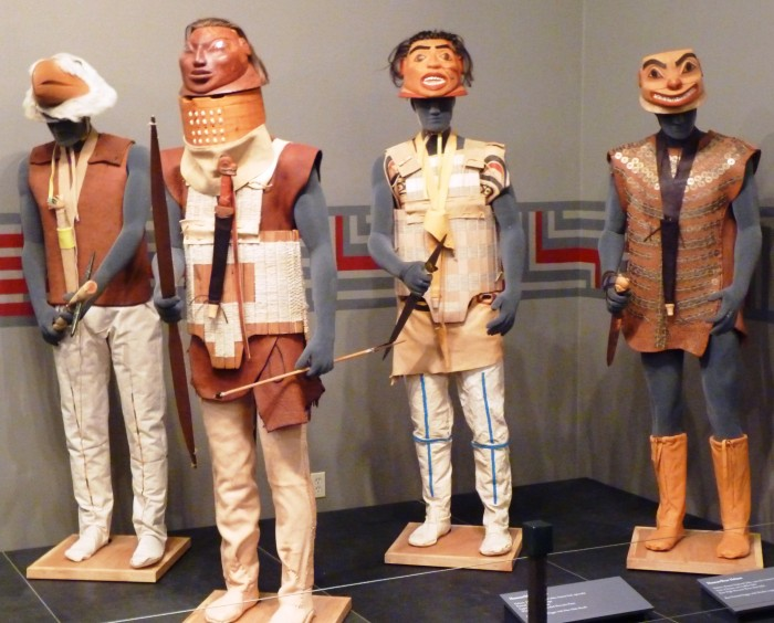 "Four armed, armored figures display Tlingit war gear created by Sitka's Tommy Joseph as part of the Alaska State Museum's ""Rainforest Warriors"" exhibit. It's one of three Alaska shows tourists will see this season."