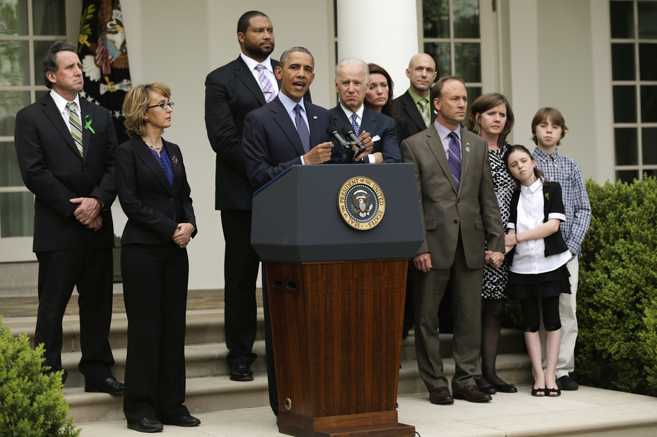 President Obama makes a statement on gun violence as Vice President Joe Biden, former U.S. Rep. Gabrielle Giffords and family members of Newtown, Conn., shooting victims look on at the White House Rose Garden. Win McNamee/Getty Images