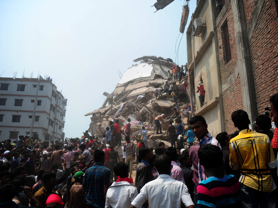 Bangladeshi volunteers and rescue workers at the site of the factory on Friday. AFP/AFP/Getty Images