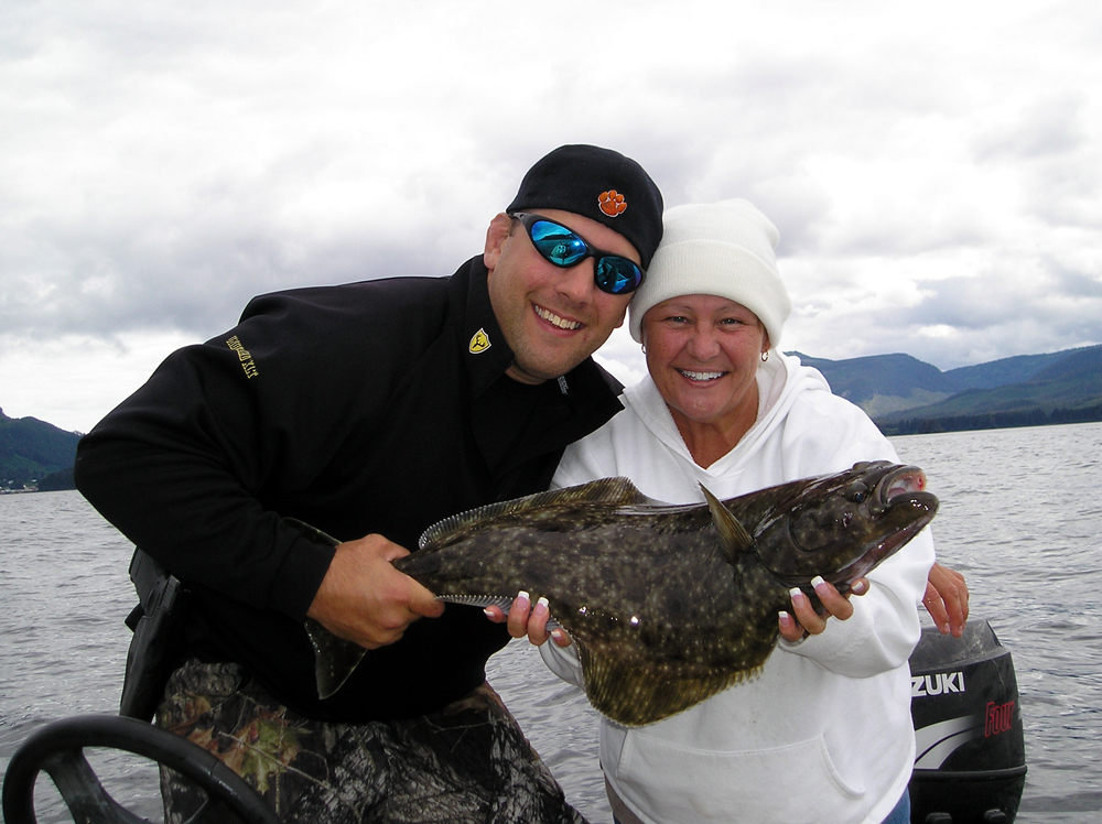 Tony Wallace and Debbie Greene pose with their 15-pound halibut that they caught  near Hoonah in August 2010, just days before he was killed. Photo courtesy of Debbie Greene.