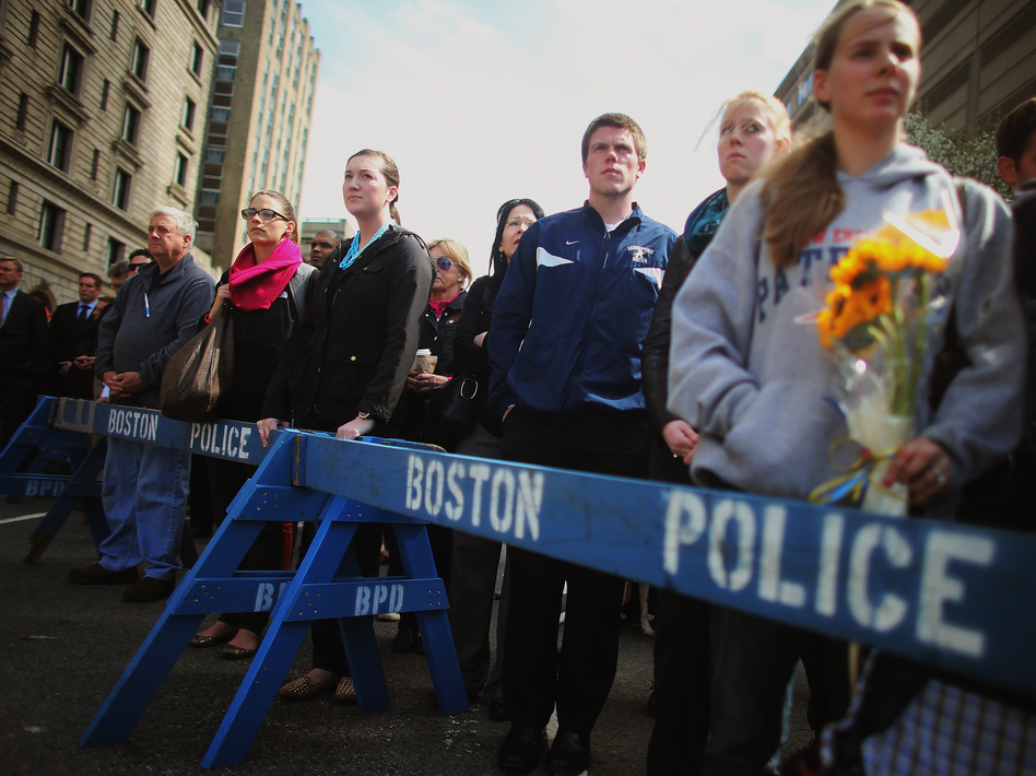 In Boston and other places across the nation, people gathered Monday for a moment of silence to honor the victims of the marathon bombing. Mario Tama/Getty Images