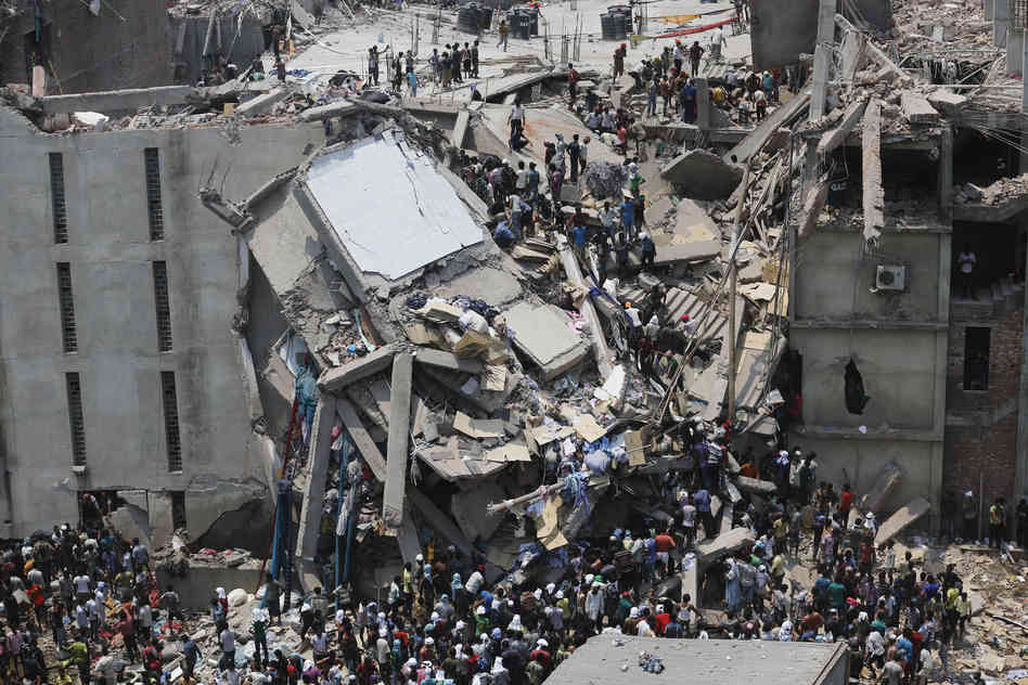More than 70 people are dead and some 600 injured in the collapse of an eight-story housing garment factories and a shopping center. Andrew Biraj /Reuters /Landov