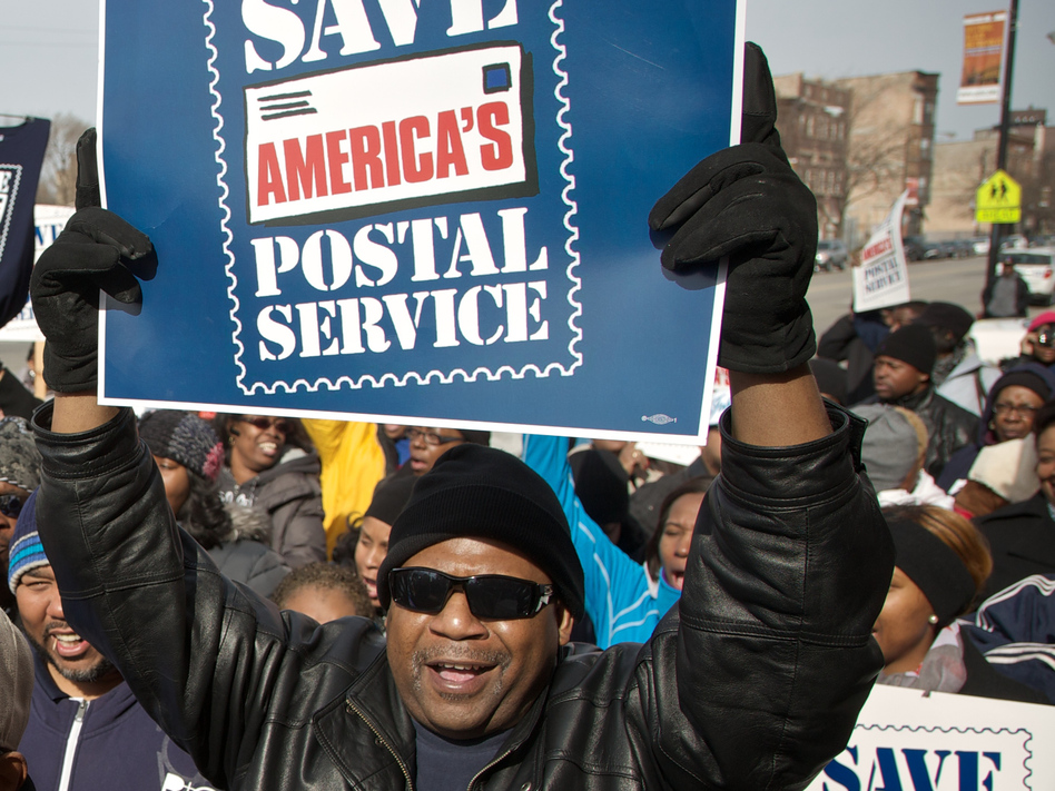 A Chicago postal worker protests in support of Saturday mail delivery in February. John Gress/Getty Images