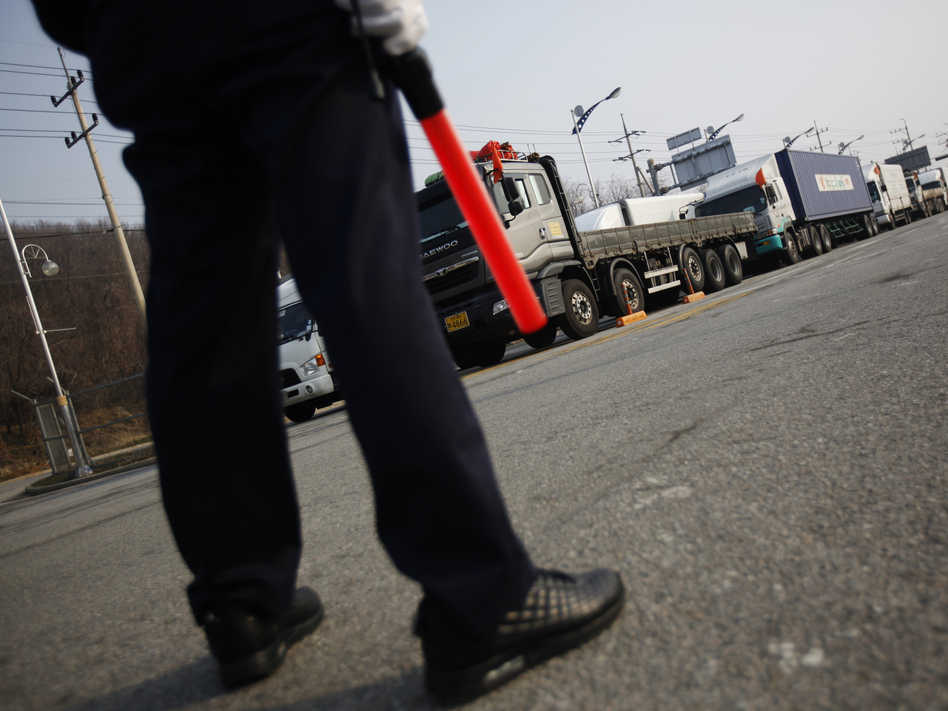 On Thursday, a South Korean security guard kept watch as South Korean trucks waited to enter the Kaesong industrial complex in North Korea. For the second day, the North blocked the trucks and workers from the South from entering its territory. Kim Hong-ji /Reuters /Landov