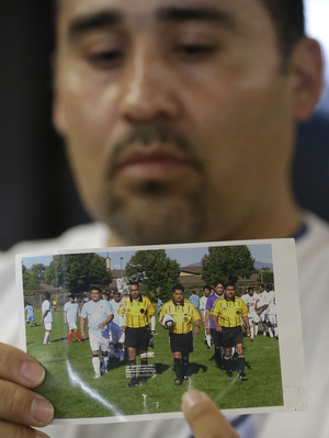 Soccer referee Ricardo Portillo died Saturday, after being struck by a player. Here, Portfillo, is seen holding a soccer ball, in a photo held by his brother-in-law, Jose Lopez, Thursday. Rick Bowmer/AP