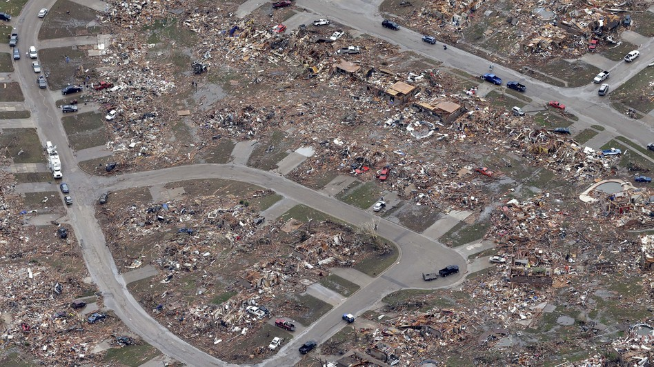 An aerial view shows an entire neighborhood destroyed by Monday's tornado in Moore, Okla. Tony Gutierrez/AP