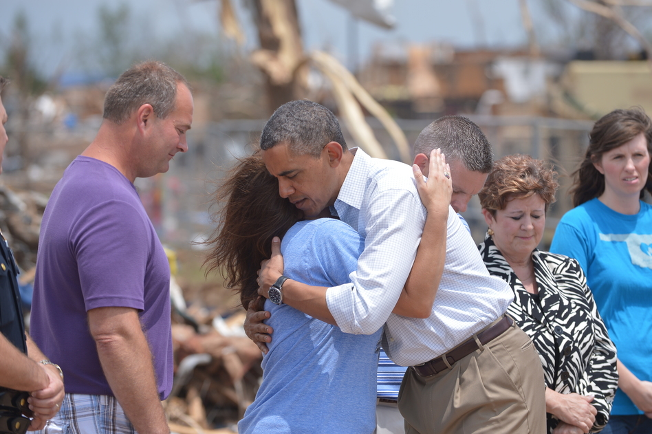President Obama is greeted as he tours a tornado affected area on Sunday in Moore, Oklahoma. Mandel Ngan /AFP/Getty Images