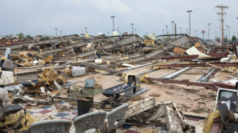 The destruction was wide and devastating in Moore, Okla., on Monday after a tornado roared through. Richard Rowe/Reuters /Landov
