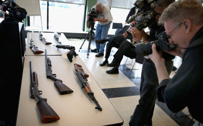The U.S. rate of gun homicides and other crimes fell after 1993, according to two studies released Tuesday. But a survey showed that only 12 percent of Americans said they felt gun homicides had fallen. Scott Olson/Getty Images