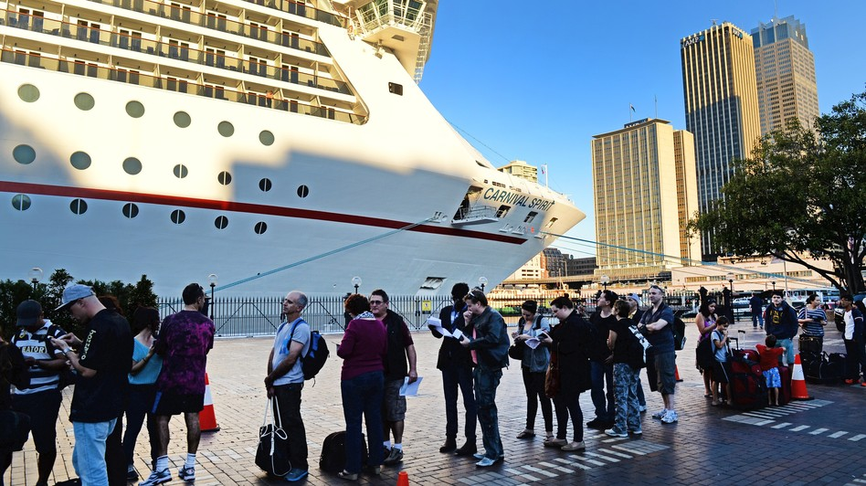 Passengers queue at Sydney's Circular Quay to board the Carnival Spirit for a Pacific cruise, on Thursday. William West/AFP/Getty Images