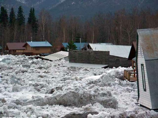 Massive ice blocks and flooding inundate the town of Eagle, Alaska, during the 2009 Alaska floods.