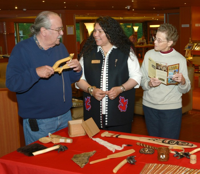 Cultural Heritage Guide Faith Grant discusses Tlingit heritage with cruise ship visitors. Courtesy Alaska Native Voices.