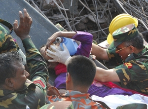 Rescuers carry a survivor who was buried for 17 days under the rubble of a building that collapsed in Saver, near Dhaka, Bangladesh. Parvez Ahmad Rony/AP