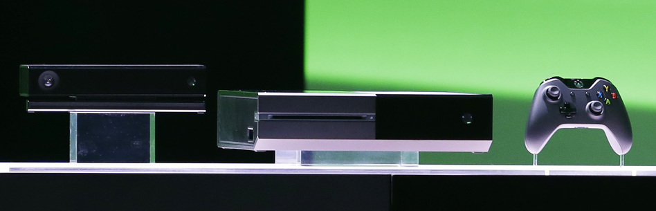 The new Xbox One entertainment and gaming system was unveiled Tuesday by Microsoft. The console includes live TV and advanced voice commands. Ted S. Warren/AP