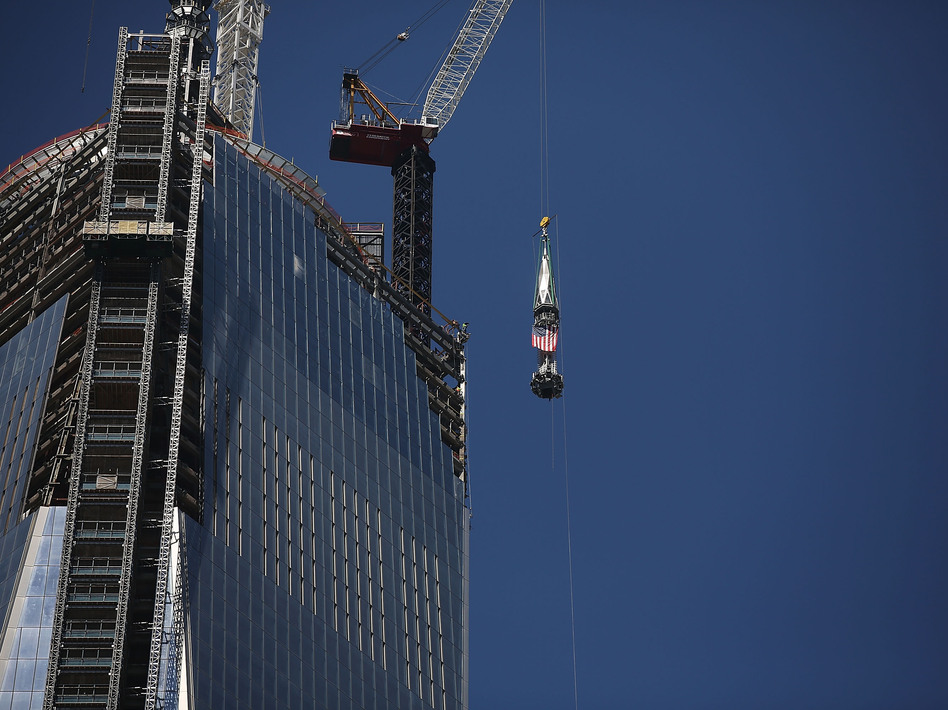 The 408-foot spire was hoisted onto a temporary platform at the top of One World Trade Center on Thursday. Spencer Platt/Getty Images
