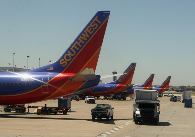Southwest airline jets are lined up at Long Island MacArthur Islip airport in 2010. Departures at the New York City suburban airport dropped nearly 50 percent between 2007 and 2012, according to an MIT study. Bruce Bennett/Getty Images