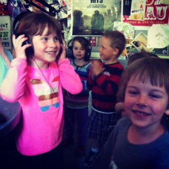 4-year-olds from Discovery Preschool studio listen to the Beastie Boys in the KXLL studio after recording station IDs and singing songs.