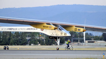 The Solar Impulse takes off from Moffett Field NASA Ames Research Center in Mountain View, Calif., Friday, as a team member rides an electric bike alongside the plane. AFP/AFP/Getty Images