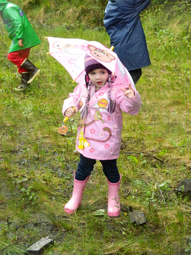 A young rainboot racer tests her pink raingear before Saturday's race