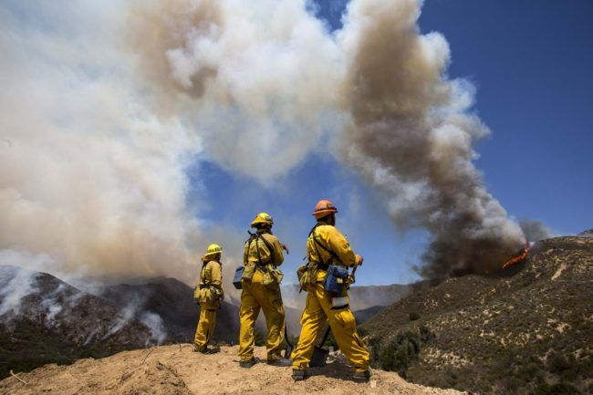 Firefighters keep watch at Green Valley as the fire has burned more than 1,400 acres since Thursday in the Angeles National Forest just north of Castaic, in California. Zhao Hanrong /Xinhua /Landov