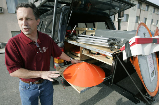 Tornado chaser Tim Samaras shows the probes he uses when trying to collect data from a tornado. This photo was taken May 26, 2006, in Ames, Iowa. Charlie Neibergall/AP